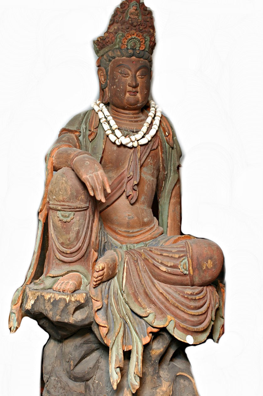 A Chinese Carved Wood Figure of Guanyin, Qing Dynasty (1644-1911), 18th century