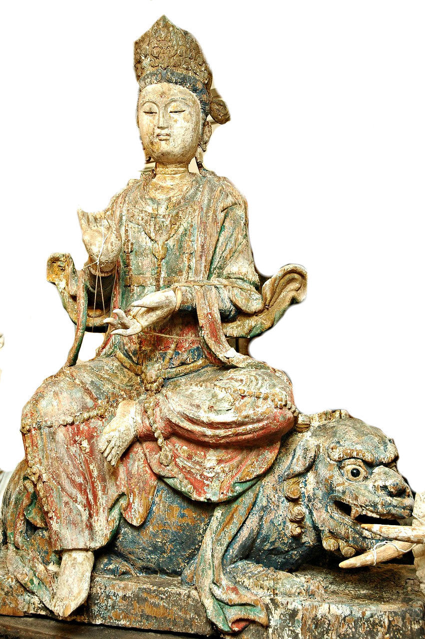 A Chinese Carved Wood Figure of Guanyin Riding a Lion, Late Ming/Early Qing Dynasty