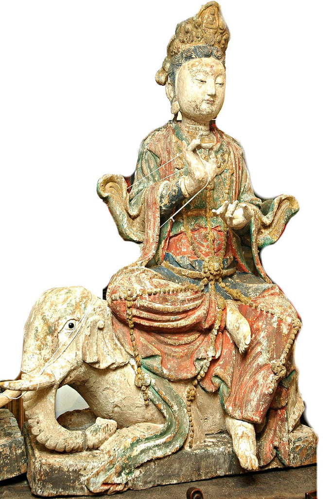A Chinese Carved Wood Figure of Guanyin Riding an Elephant, Late Ming/Early Qing Dynasty