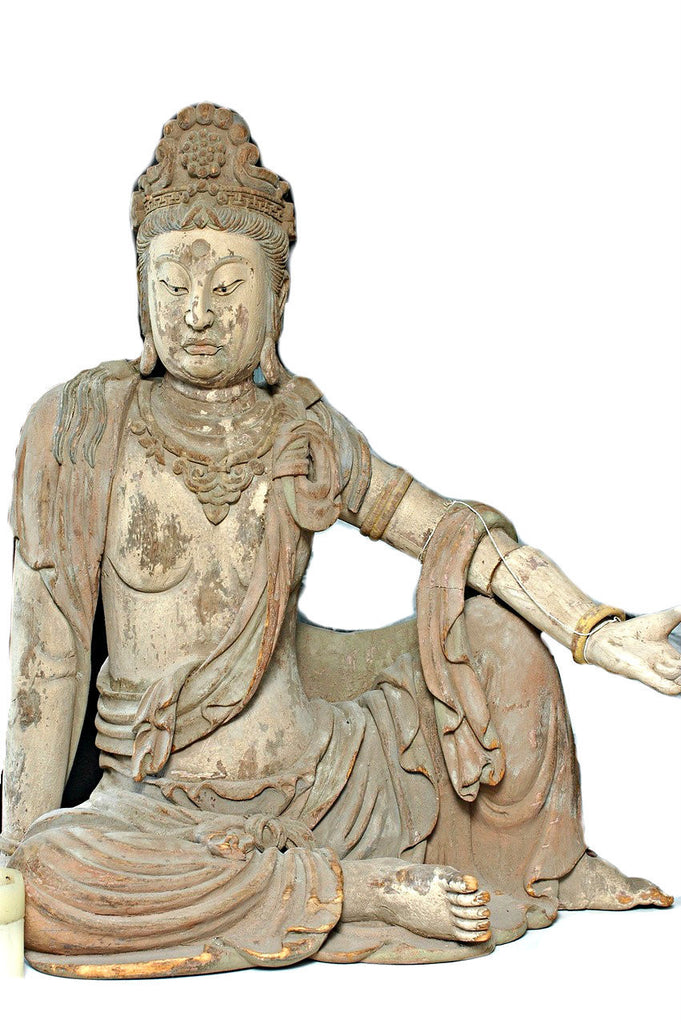 A Chinese Carved Wood Figure of Guanyin, Mid Ming Dynasty (circa 15th century)