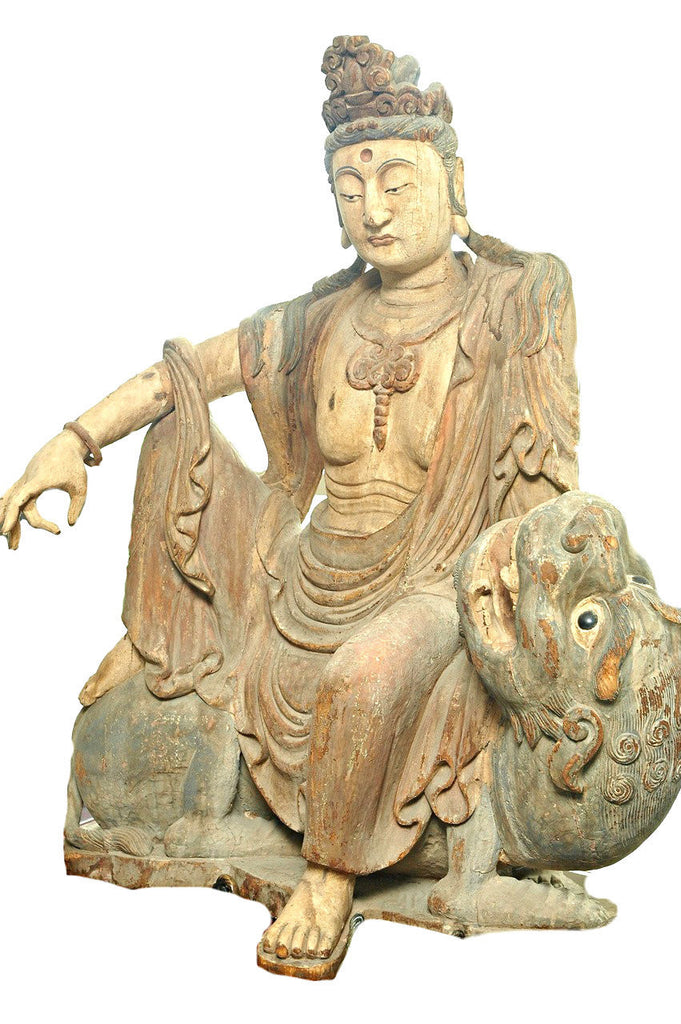 A Chinese Carved Wood Figure of Guanyin Riding a Qilin, Ming Dynasty (1368-1644)