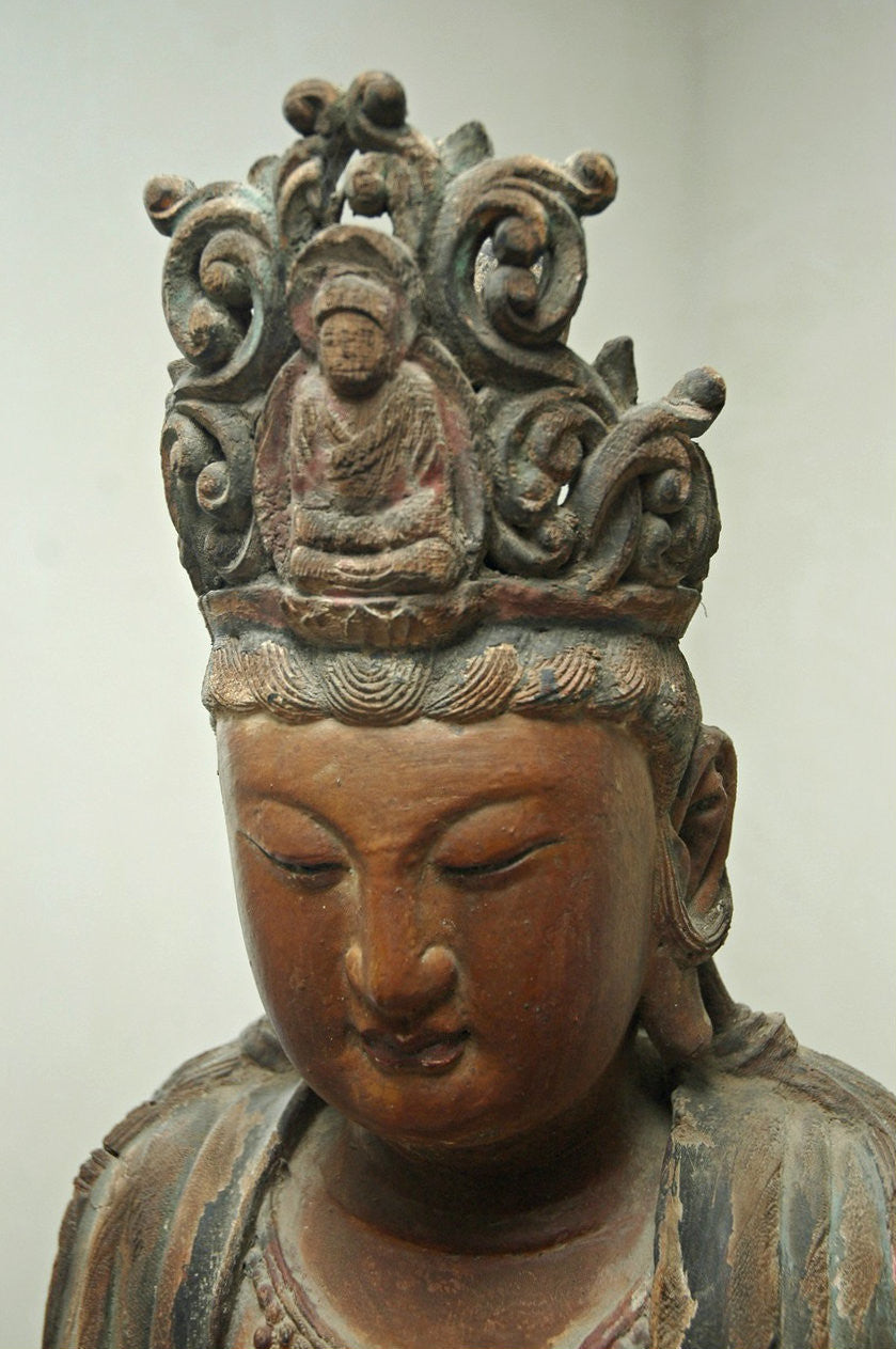 A Chinese Carved Wood Figure of Guanyin Riding a Qilin, Late Ming Dynasty (1368-1644)