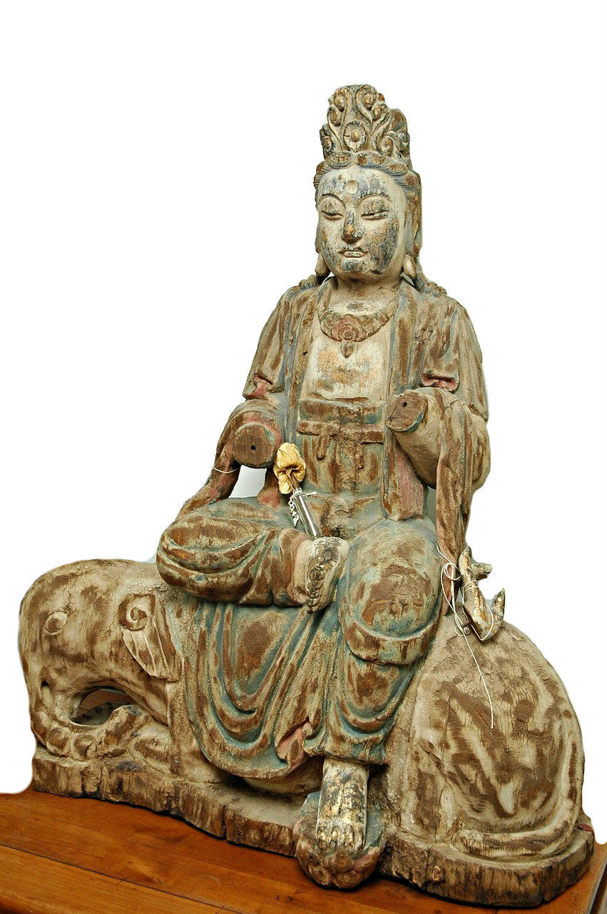 A Chinese Carved Wood Figure of Guanyin Riding an Elephant, Late Ming Dynasty (1368-1644)