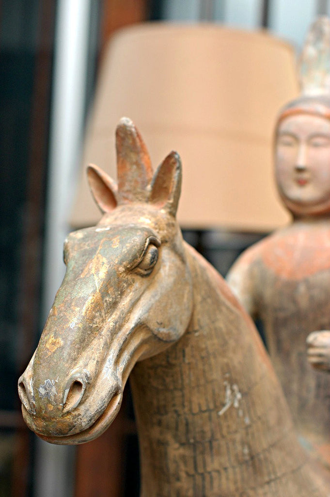 A Chinese Painted Pottery Equestrian Figure  Tang Dynasty (618-906 A.D.)