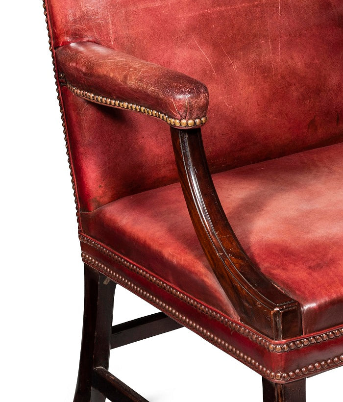 A Pair of Late 19th-Early 20th Century Burgundy Leather Gainsborough Chairs