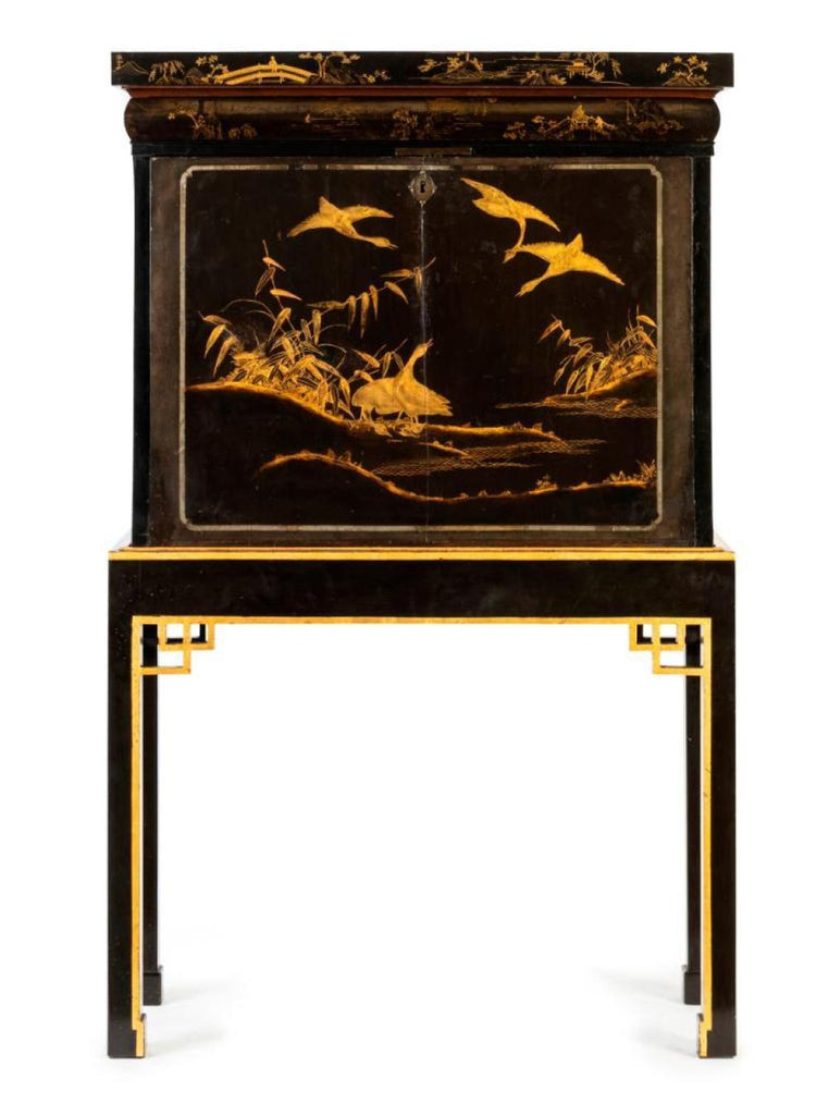 A Black Lacquered and Gilt Chinoiserie Secretaire Abattant