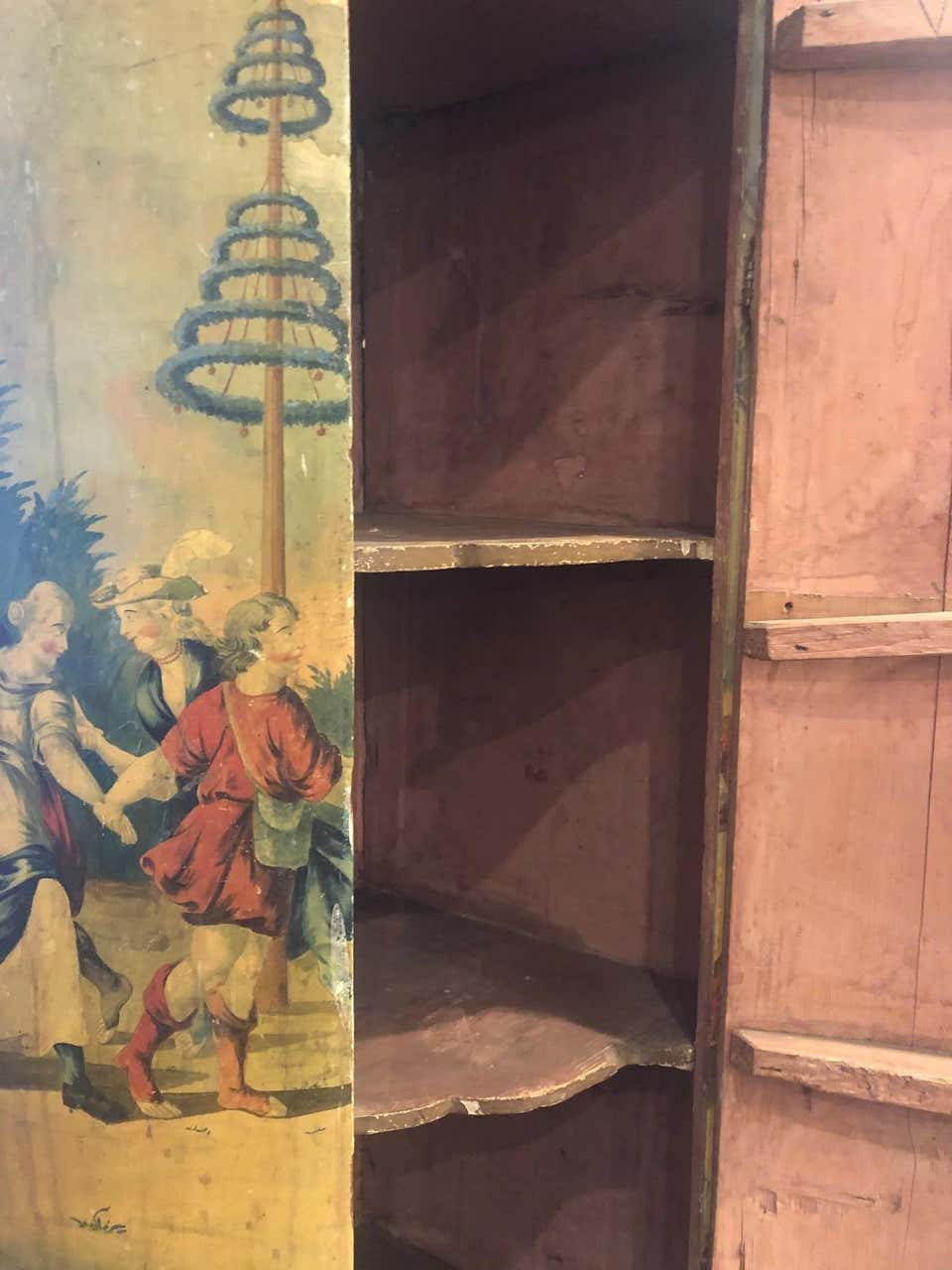 A Pair of 19th Century Dutch Polychrome Painted Corner Cupboards