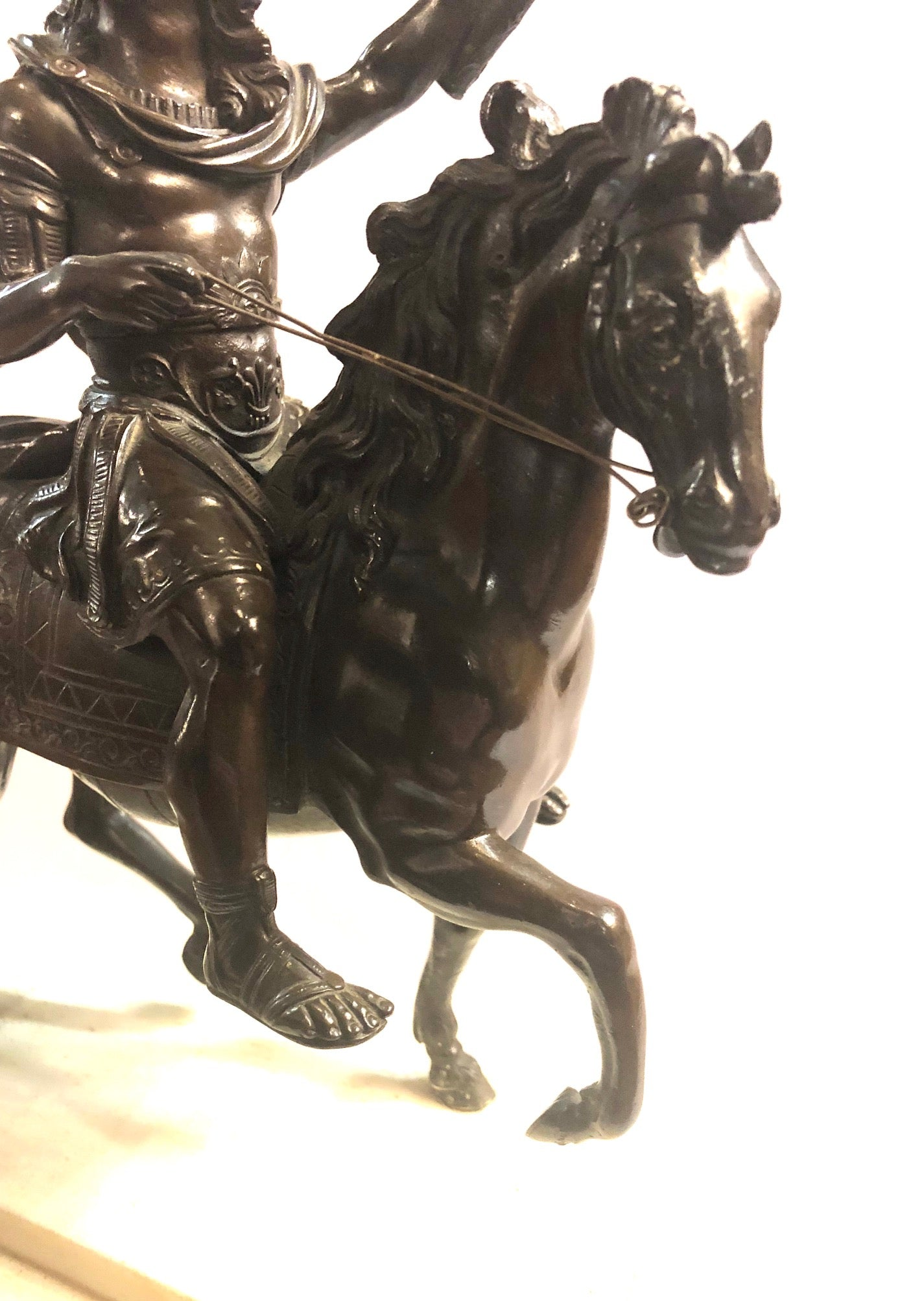 An 18th Century Bronze Equestrian Group of Louis XIV on Horseback