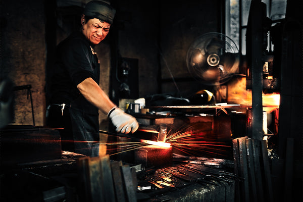 Forging the steel to make Japanese knife
