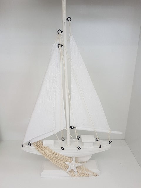 White Sailing Boat with Starfish