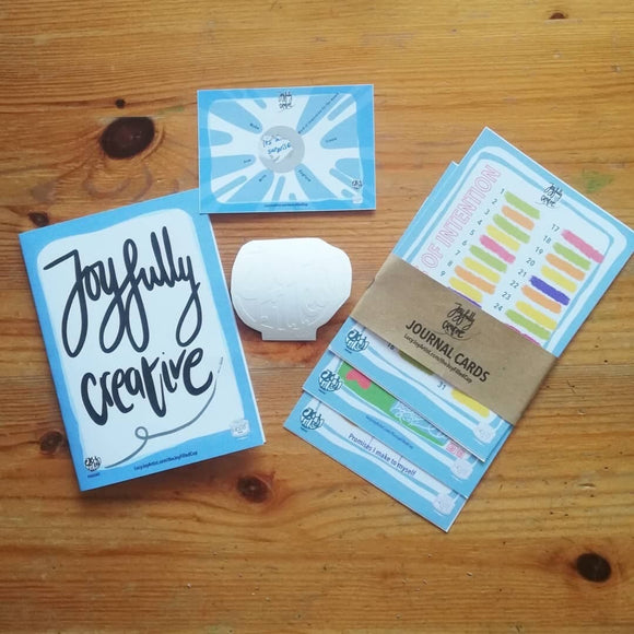 Flat lay of the joyful cup cards by Lucy Joy