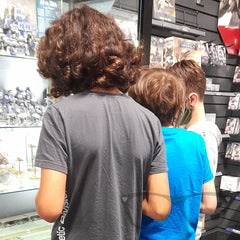 The boys look at the display shelves at Games Workshop Warhammer, Nottingham