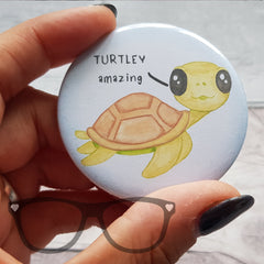 "58mm badge showing a cute turtle that says ""Turtley Amazing"" on a white background"