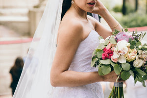 bride with diy wedding flowers