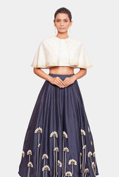 Kanakpriya embellished cape top and navy lehenga