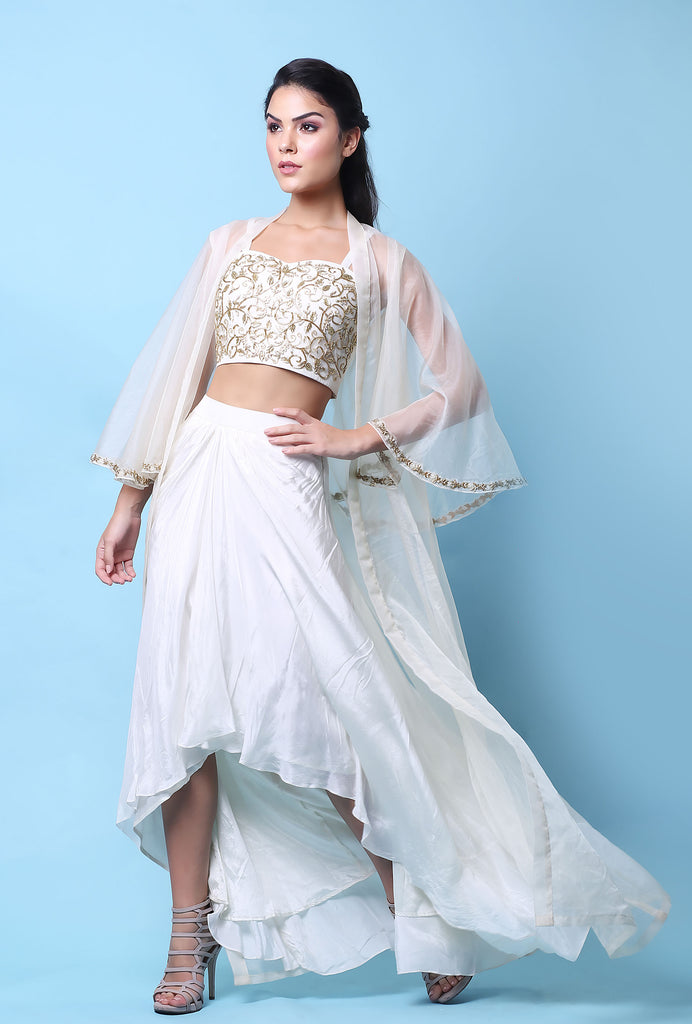 Jhilmil white and gold lehenga set