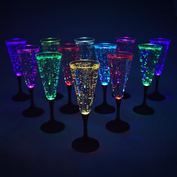 set of light up LED Champagne Glasses, pool safe with plastic material by glow city