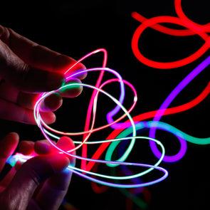 hand holding fiber optic laser wire glow strand for costume and art lighting by glowcity