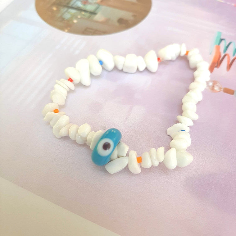Bracelet evil eye in white coral
