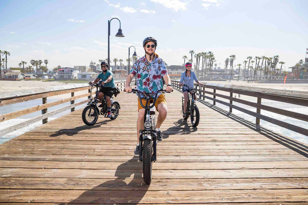 Friends test riding the RadRunner Electric Utility Bike