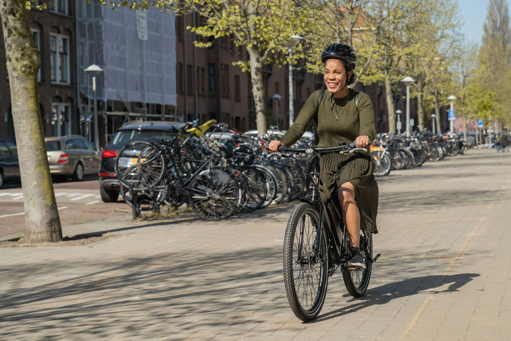 Women riding home on her RadMission ebike