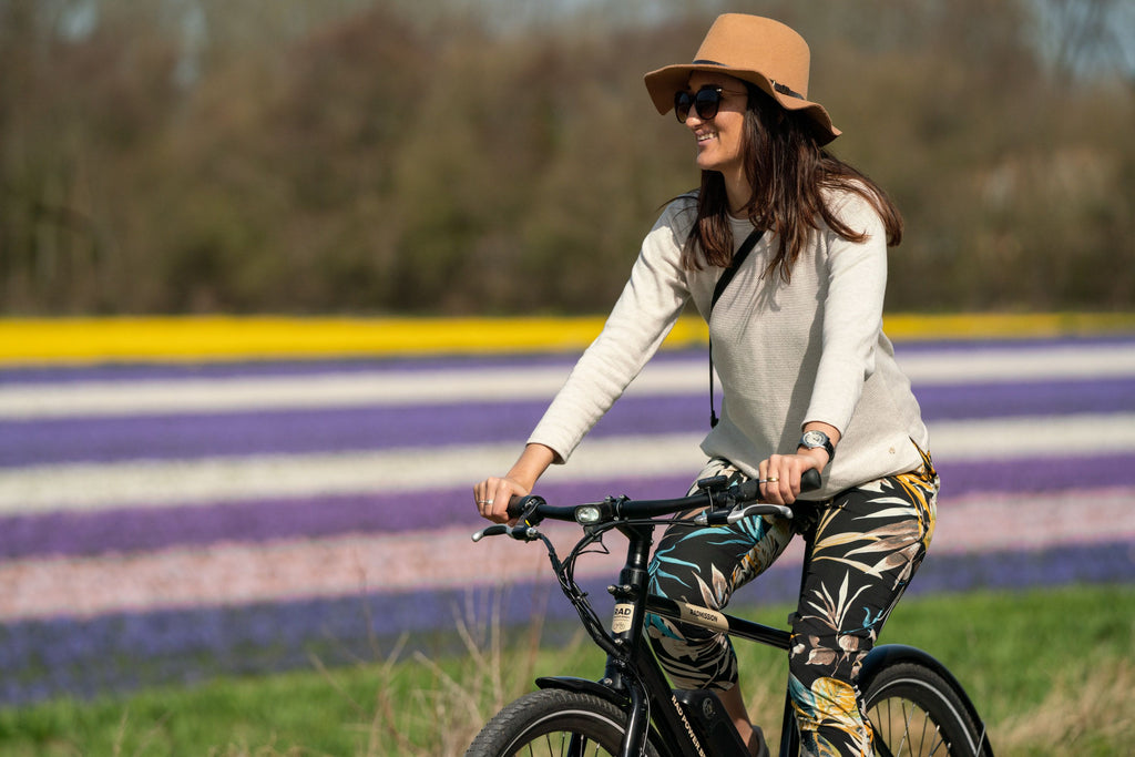 Riding electric RadMission ebike through tulip fields in The Netherlands