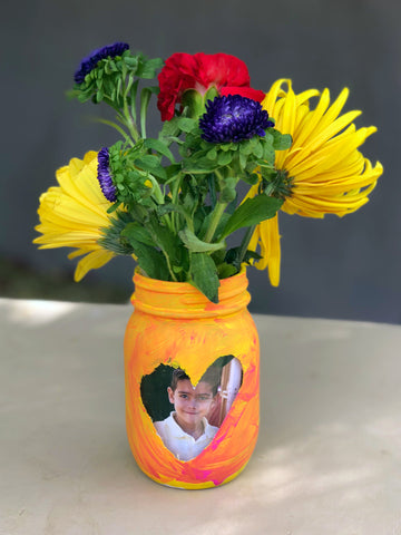jar with photo and flowers