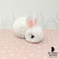 Black-eyed white pom pom bunny