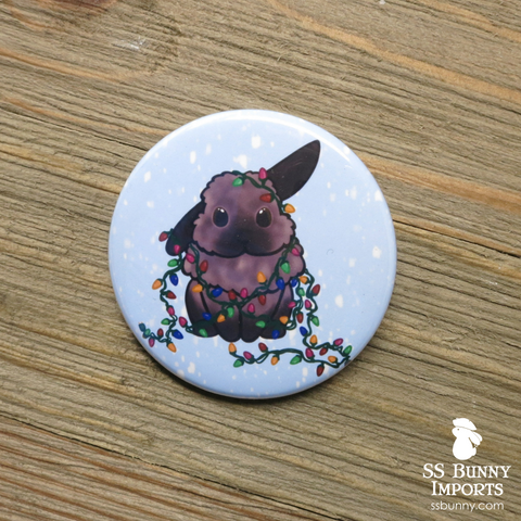 Tort half lop with holiday lights pinback button