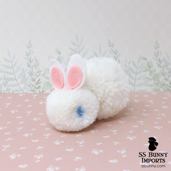 Blue-eyed white pom pom bunny