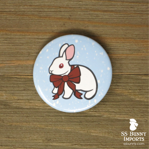 White rabbit with gift bow pinback button