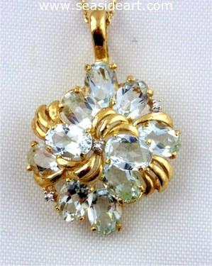 14kt yellow gold pendant with diamonds and aquamarines