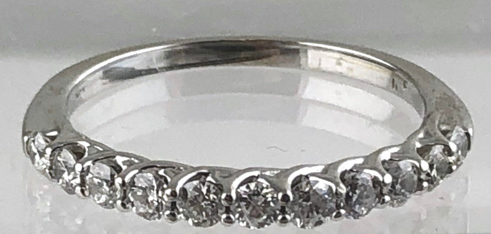 14kt white gold tapering band set with a total of eleven round brilliant cut diamonds