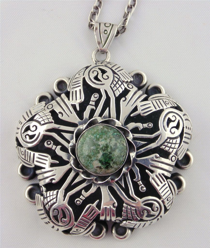 Los Ballesteros necklace in sterling silver with natural green turquoise