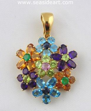 A Ladie's 18kt Yellow Gold Pendant with mutli gemstones.