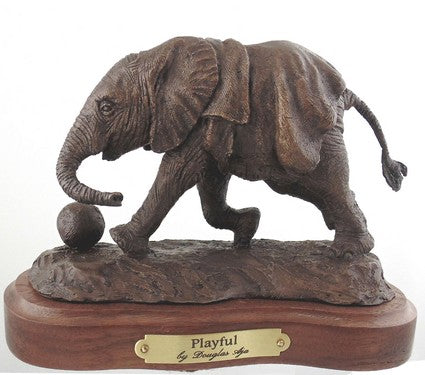 Playful is a bronze sculpture of a baby elephant by Douglas Aja