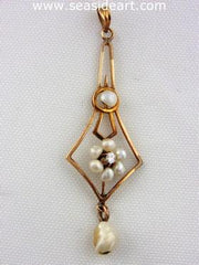 antique 9K yellow gold lavaliere filigree style pendant with one Swiss cut diamond (0.03ct) and six baroque shaped natural pearls