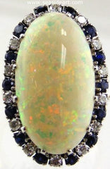 Opal, sapphire and diamond gold ring