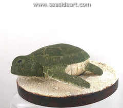 Baby Turtle is a wood carving with mixed media by Jim Carpenter