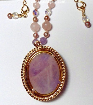 A Pink Quartz Pendant With Iris by Jewelry - Seaside Art Gallery