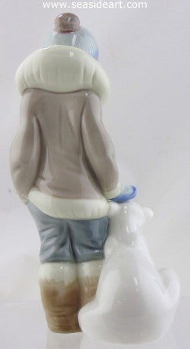 Boy With A Polar Bear Cub by Lladro - Seaside Art Gallery