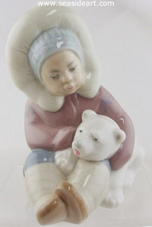 Eskimo Child with A Polar Bear by Lladro - Seaside Art Gallery