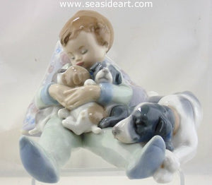 Sleeping Child With Puppies and Mama Dog by Lladro - Seaside Art Gallery