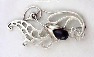 Sterling Silver Floral Brooch with Amethyst by Margot de Taxco