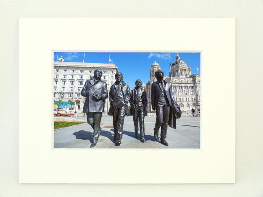 Beatles statue over looked by the port of Liverpool Building
