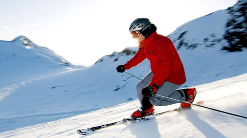 telemark skier in red boots and jacket