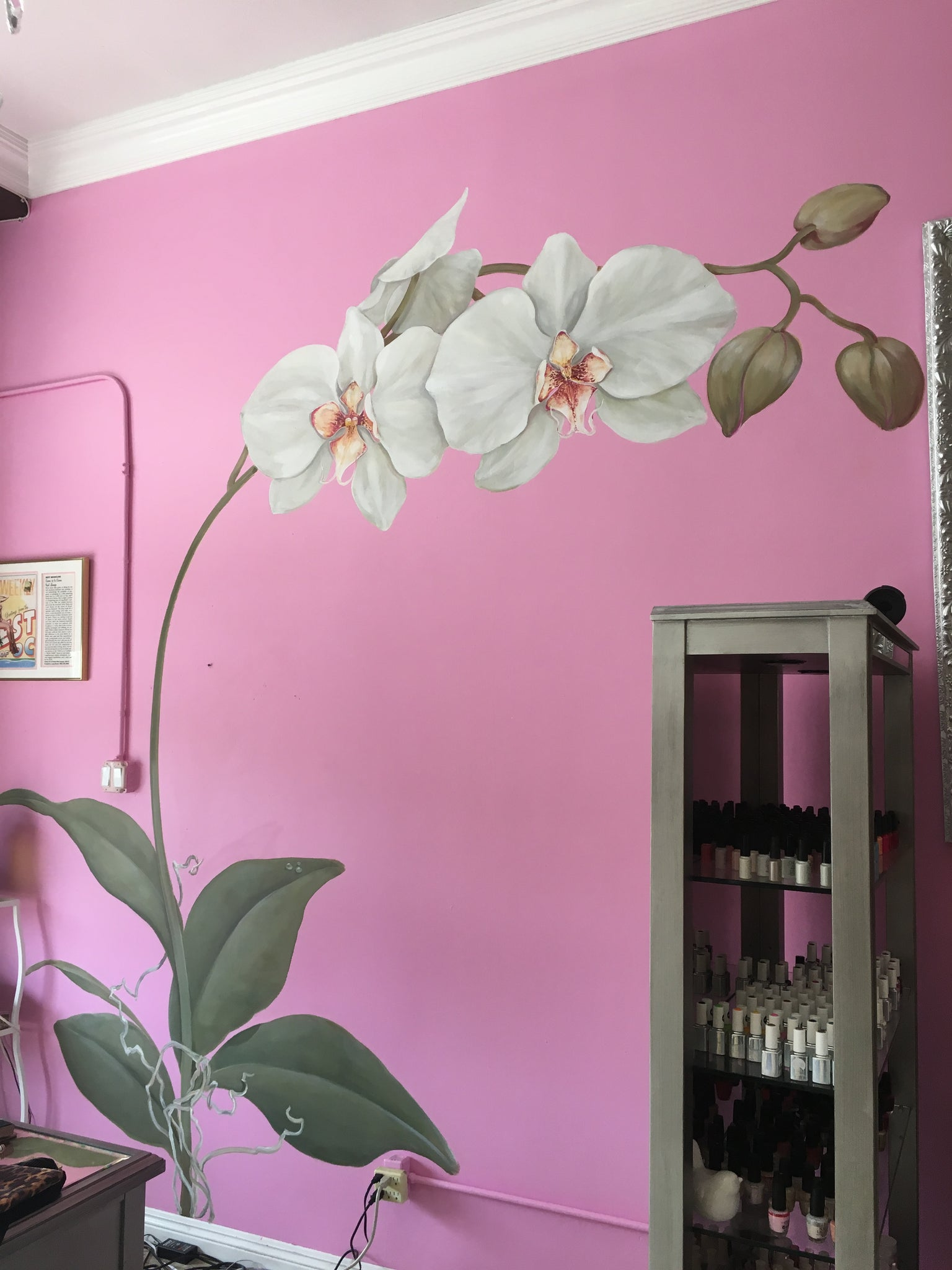 Large decorative orchid painted in my local nail salon wrapping around the mirror
