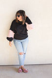 black and pink fuzzy sleeve pullover
