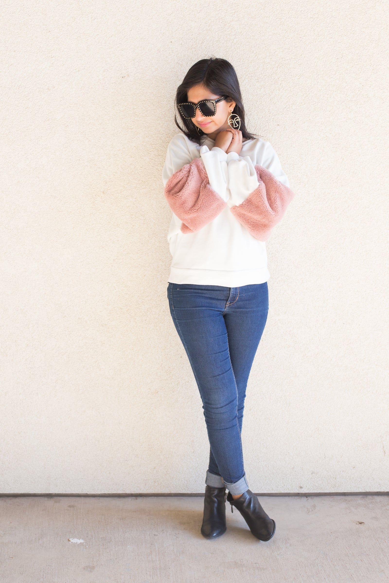 white and pink fuzzy sleeve pullover