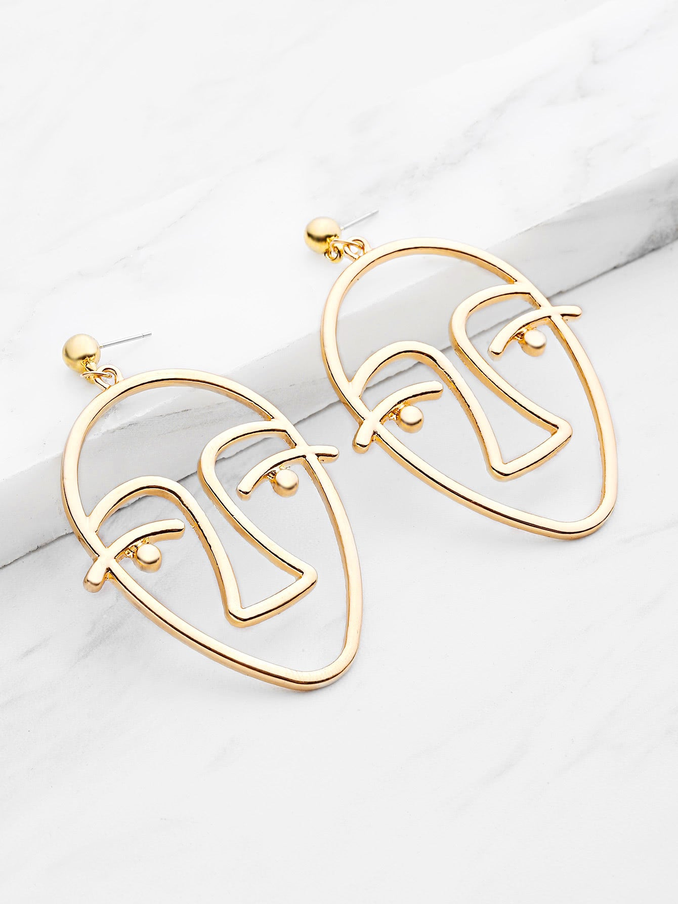 minimalistic gold face drop earrings